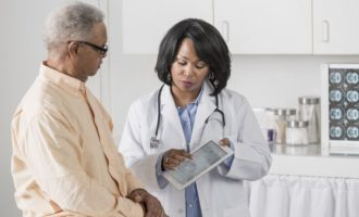 Doctor showing patient digital tablet