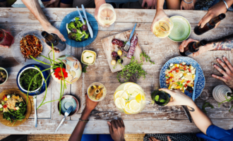 Friends sitting around table with food