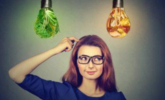 Woman deciding on diet - junk food or vegetables