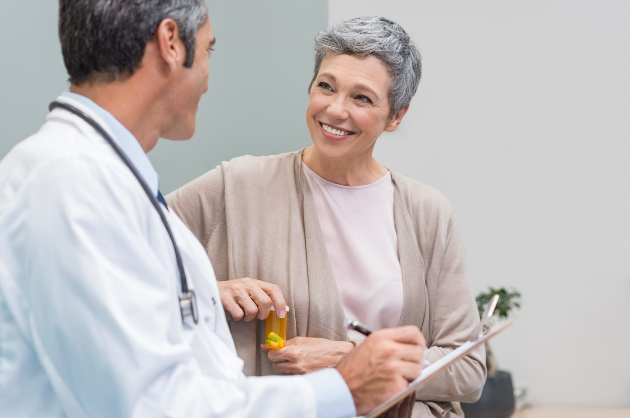 Woman smiling talking to her doctor