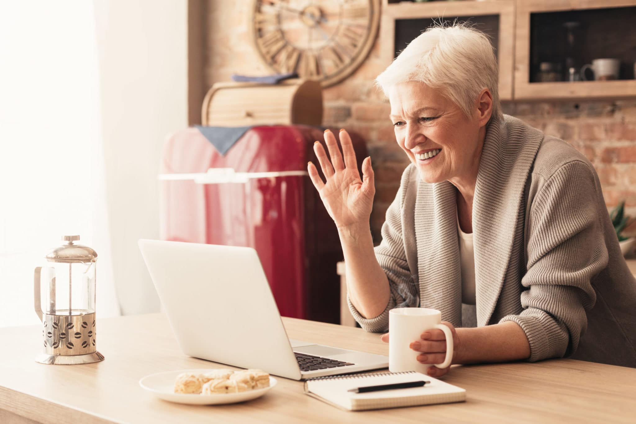 Elderly woman making video call on laptop